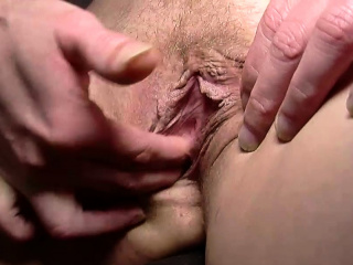 Aroused MILF fingers her juicy love tunnel