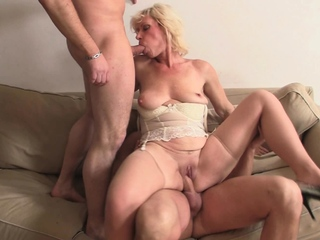 Sexy blonde grandma enjoys hot threesome