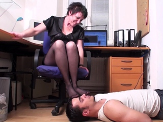 mature Thistledown and her foot smelling slave in home office